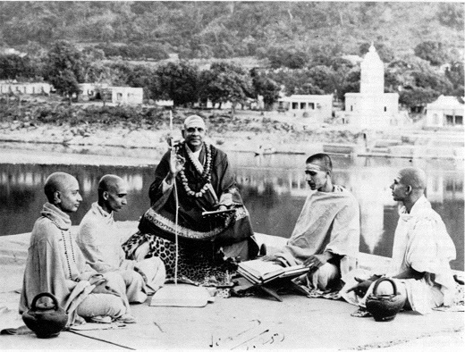 Sri Swami Sivananda with some disciples in Rishikesh, India.